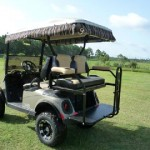 E-Z-GO New RXV Freedom Electric, lifted with custom seats, tires & wheels, and rain curtains.