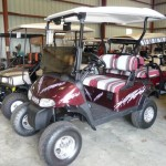 E-Z-GO RXV Freedom 2010 electric with upgraded, tires & wheels, 4-passenger kit, long top, seat covers, graphics, mirrors, fender flares, stereo, undercarriage lights and more.