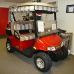 E-Z-GO RXV Freedom with Deluxe Curtains, Seatcovers, upgraded tires & wheels, windshield, cooler kit, 5-panel mirror.