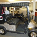 EZGO RXV With Deluxe Curtains, Seat Covers, Upgraded Tires & Wheels, Cooler, Battery Fill System & Windshield