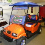 Club Car 2010 Precedent electric Reconditioned 4-passenger with custom: body, windshield, top, flip rear seat, tires & wheels, two-tone seats with logo, rear step bumper flips up for transporting, new batteries, new controller, high speed option, limited warranty. Pick your team or other designer themes to customize a car just right for you!